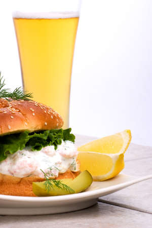 Rich-tasting, but low-calorie filling with shrimps delicious sandwich and glass of lager beer photo