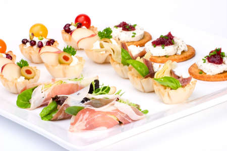 Tray with ready-to-eat fresh sandwiches on holiday table over white background photo