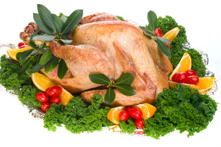 veggie tray: Garnished roasted turkey on platter over white background (studio isolated, not PS)