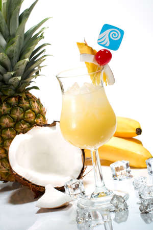maraschino: Pina Colada cocktails surrounded by tropical fruits. Rum, pineapple juice, coconut cream  garnished with slice of pineapple, coconut and maraschino cherry. Most popular cocktails series.