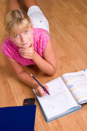 algebra calculator: Cute blonde girl doing her school homework