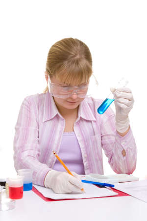 Student performing chemistry experiments with different liquids. Young adults education theme. Stock Photo - 2483063