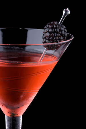 chilled: Martini in chilled glass over black background on reflection surface. Stock Photo