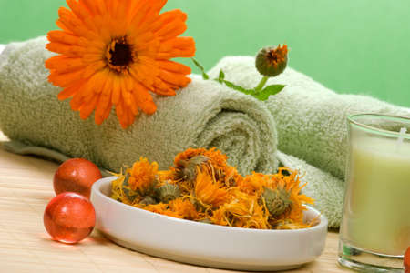 Fresh marigold spa set with fresh and dried flowers, aromatic oil balls, towels and arome candles. Best suited for relaxing and health commercials