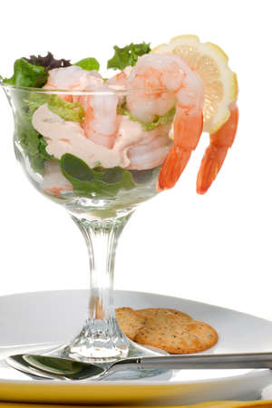 Closeup of delicious Prawn Cocktail.  Fresh jumbo shrimps, cream, lettuce leaves, lemon wedge and zesty sauce. Appetizer served in cocktail glass. photo