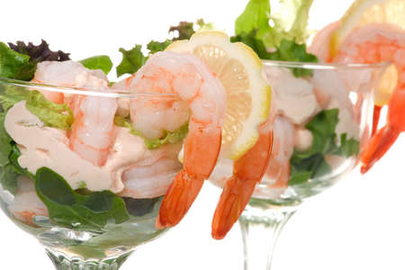 Delicious Prawn Cocktail.  Fresh jumbo shrimps, cream, lettuce leaves, lemon wedge and zesty sauce. Appetizer served in cocktail glass with whole wheat crackers. photo
