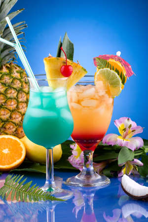Mai Tai and Blue Hawaiian cocktails surrounded by tropical fruits. Most popular cocktails series. photo