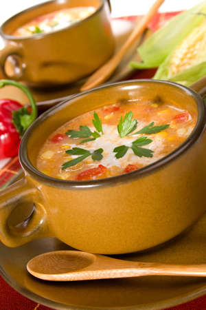 Bowl of hot delicious corn and red chilli chowder garnished with cream and fresh parsley Stock Photo - 3473116