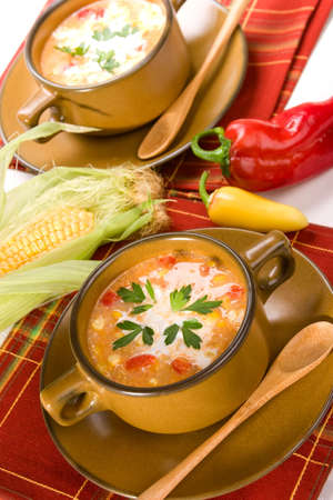 Bowls of hot delicious corn and red chilli chowder garnished with cream and fresh parsley Stock Photo - 3508902