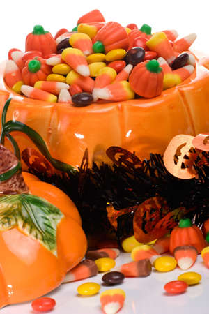 Orange pumpkin filled with delicious Halloween candies photo