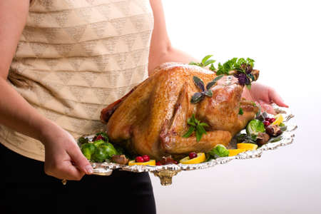 Garnished roasted turkey on platter is ready to be served Stock Photo
