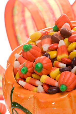 Orange pumpkin filled with delicious Halloween candies