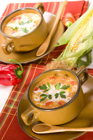 Bowls of hot delicious corn and red chilli chowder garnished with cream and fresh parsley Stok Fotoğraf