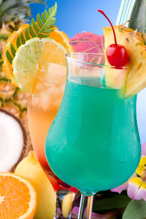 mai: Closeup of Mai Tai and Blue Hawaiian cocktails surrounded by tropical fruits. Most popular cocktails series.