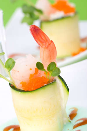 garnished: Two Zucchini Rolls with shrimps and seasoned capelin roe (Masago). Garnished with wasabi sauce.