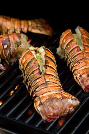 lobster: Closeup of delicious juicy lobster tails is grilling on open fire Stock Photo