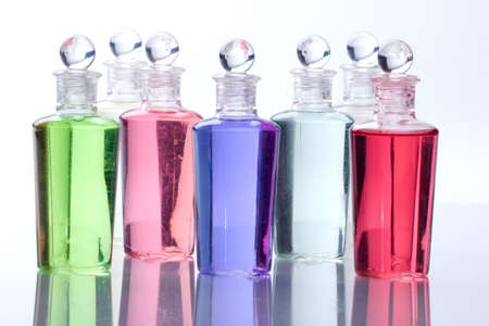 multi colors: Spa bottles - multi colors - on reflective surface