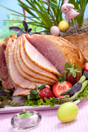 Honey ham on Easter table with eggs, flowers and decoration Stock Photo - 4335280