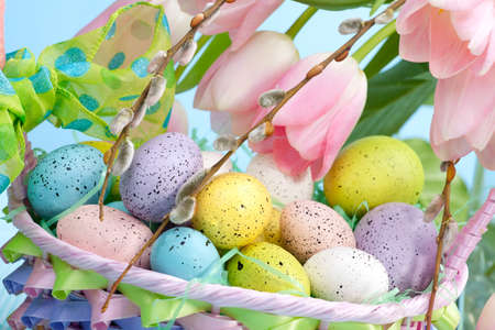 Closeup of basket of easter eggs and pink tulips photo