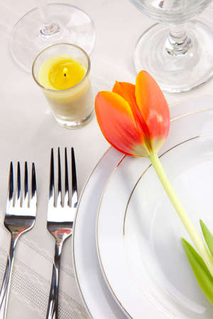 Fine food and wine spring table settings with fresh tulips Stock Photo - 4623264