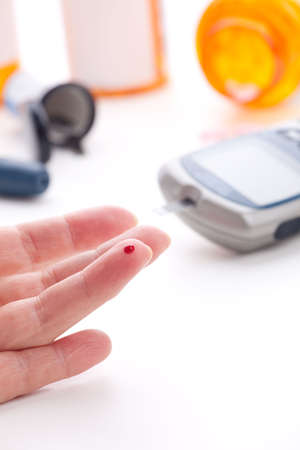 Diabetic is doing a glucose level finger blood test Stock Photo - 4665374