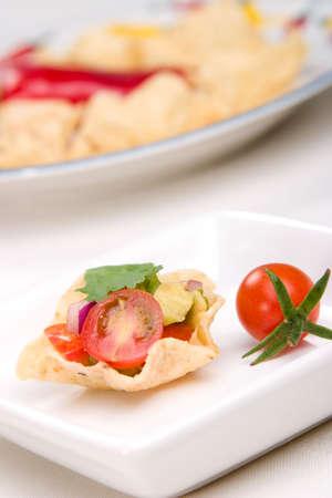 corn tortilla: Corn tortilla chips fill with fresh cherry tomatoes salsa.