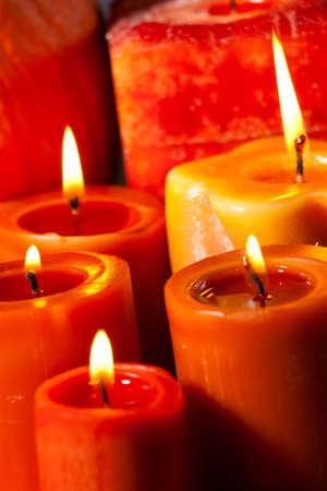 Closeup of festive aromatic candles burning merrily