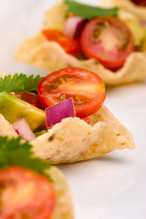 Corn tortilla chips fill with fresh cherry tomatoes salsa.
