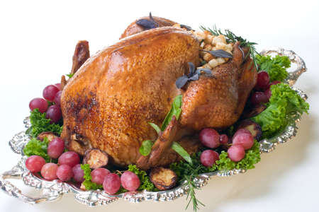 garnished: Garnished roasted turkey on platter over white background