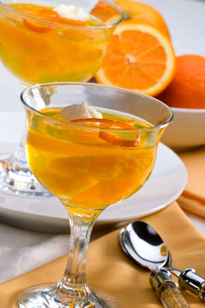 zest: Delicious Champagne Orange jelly served with whipped cream and orange zest