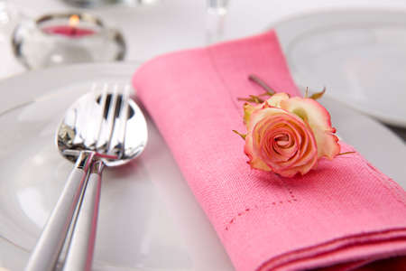 arrangment: Romantic table settings. Arrangments with fresh roses and scented candles