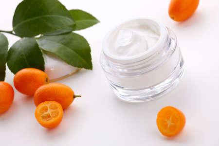 cumquat: Closeup of jar of moisturizing face cream and fresh citrus