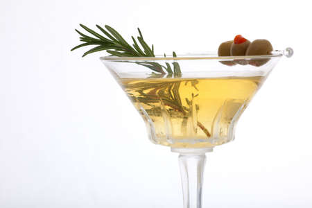 Glass of Rosemary Martini - gin, vodka, garnished with fresh rosemary sprig and olives Reklamní fotografie