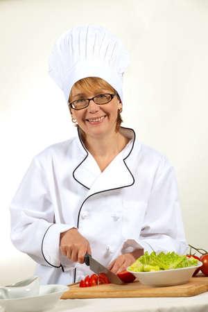 Executive chef preparing fresh organic salad, pouring dressing photo