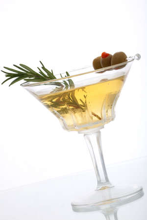 Glass of Rosemary Martini - gin, vodka, garnished with fresh rosemary sprig and olives photo