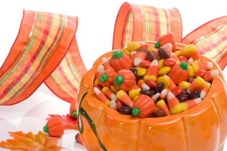 Orange pumpkin filled with delicious Halloween candies photo