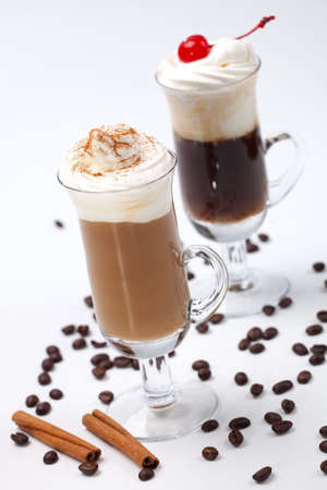 Two glasses of tasty Coffee Cocktails with whipped cream and maraschino cherry - Coffee Warmers series Stock Photo - 5537865