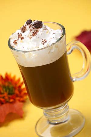 Closeup of tasty Cafe Royal Cocktail, Baileys, Drambuie, Tia Maria, coffee and whipped cream - Coffee Warmers series photo