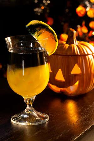 alcohol screwdriver: Closeup of Rotten Pumpkin Cocktail, black vodka, orange juice - Halloween drinks series