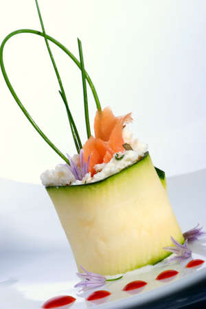 Closeup of Zucchini Roll with smoked salmon and herbed Goat cheese. Fresh chives.