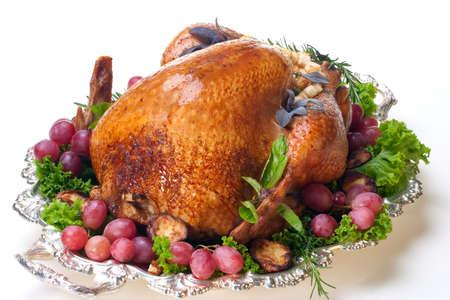 Garnished roasted turkey on platter over white background Stock Photo - 5651323