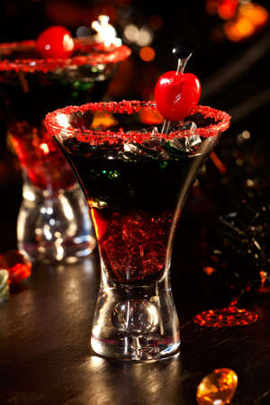 Closeup of Devils Blood Cocktail, black vodka, cranberry juice - Halloween drinks series photo