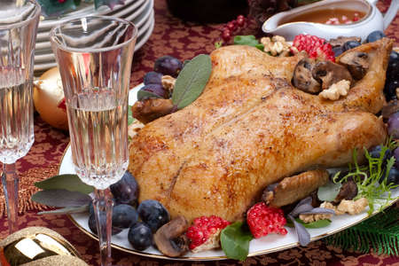 garnished: Garnished roasted duck on Christmas decorated table Stock Photo