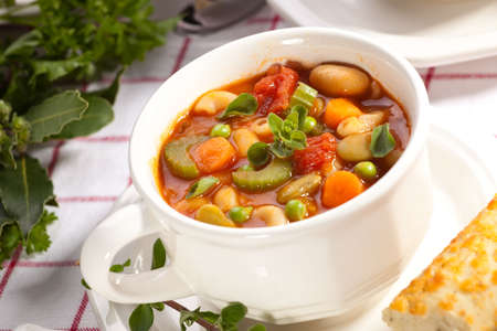 Closeup of bowl of hot fresh Minestrone soup and cheese garlic breadsticks Stock Photo - 5745463