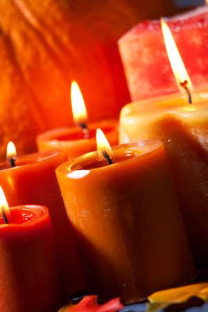 Closeup of festive aromatic candles burning merrily - fall theme photo