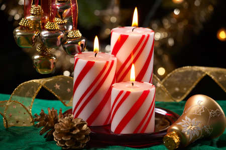objects: Closeup of peppermint candles, flutes of champaine champagne and Christmas tree with lights out of focus in background. Shallow DOF.