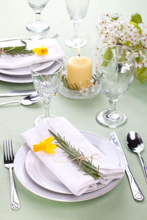 restaurant setting: Daffodil table settings. Arrangements with yellow daffodil and fresh rosemary