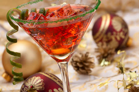 martini glass: Glass of Christmas Cocktail in martini glass and Christmas ornaments Stock Photo