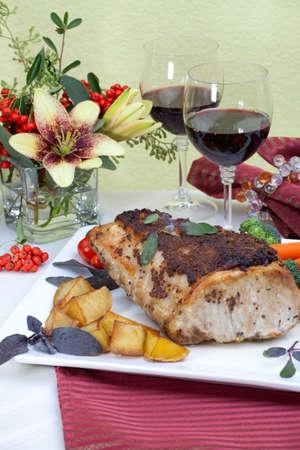 Delicious sage  mustard pork tenderloin with vegetables Banco de Imagens