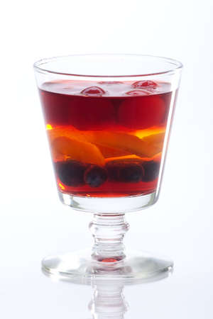 Delicious multi - layered fruit jelly made from wild strawberries, blueberries and slice of apricot.